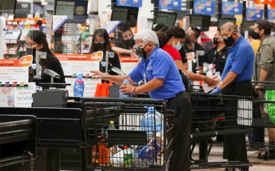 Baggers are back at work at a Chedraui store in Mexico City.